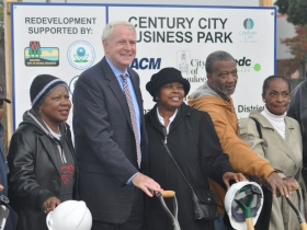Mayor Barret with members of the Triangle Neighborhood Association.  Yvonne McCaskill, in black hat standing to the left of the mayor.