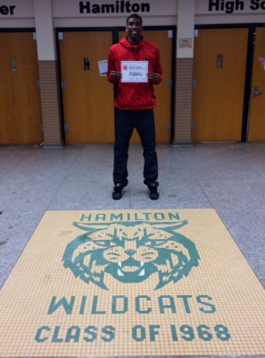 MPS' Hamilton honor student and basketball standout Kevon Looney with his McDonald's All American certificate