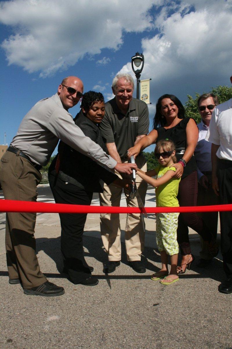 Alderman Nik Kovac, Alderwoman Milele Coggs, Mayor Tom Barrett, and Gina Gruenwald at the Pleasant Street Lift Bridge ribbon cutting.