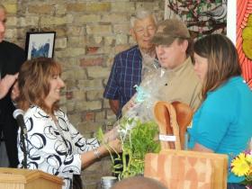 Charlotte John-Gomez presenting gift to Felisha Wild and Janelle Phallen.