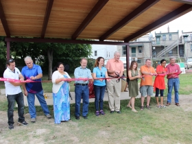 Arlington Heights Park Bandshell Ribbon Cutting. L-R: Natanael Martinez, Layton Boulevard West Neighbors; Mike DeHays, Silver City Resident; Vanessa Llanas, City of Milwaukee Neighborhood Improvement Development Corporation; Leo Ries, LISC Milwaukee; County Chairwoman Marina Dimitrijevic; Milwaukee Mayor Tom Barrett; Charlotte John-Gomez, Layton Boulevard West Neighbors; State Representative Josh Zepnick; Jezamil Vega-Skeels, LBWN; Richard Schalk.