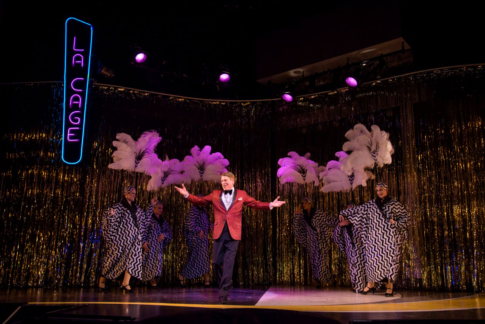 Norman Moses (Georges) with the Cagelles in Skylight Music Theatre's La Cage Aux Folles