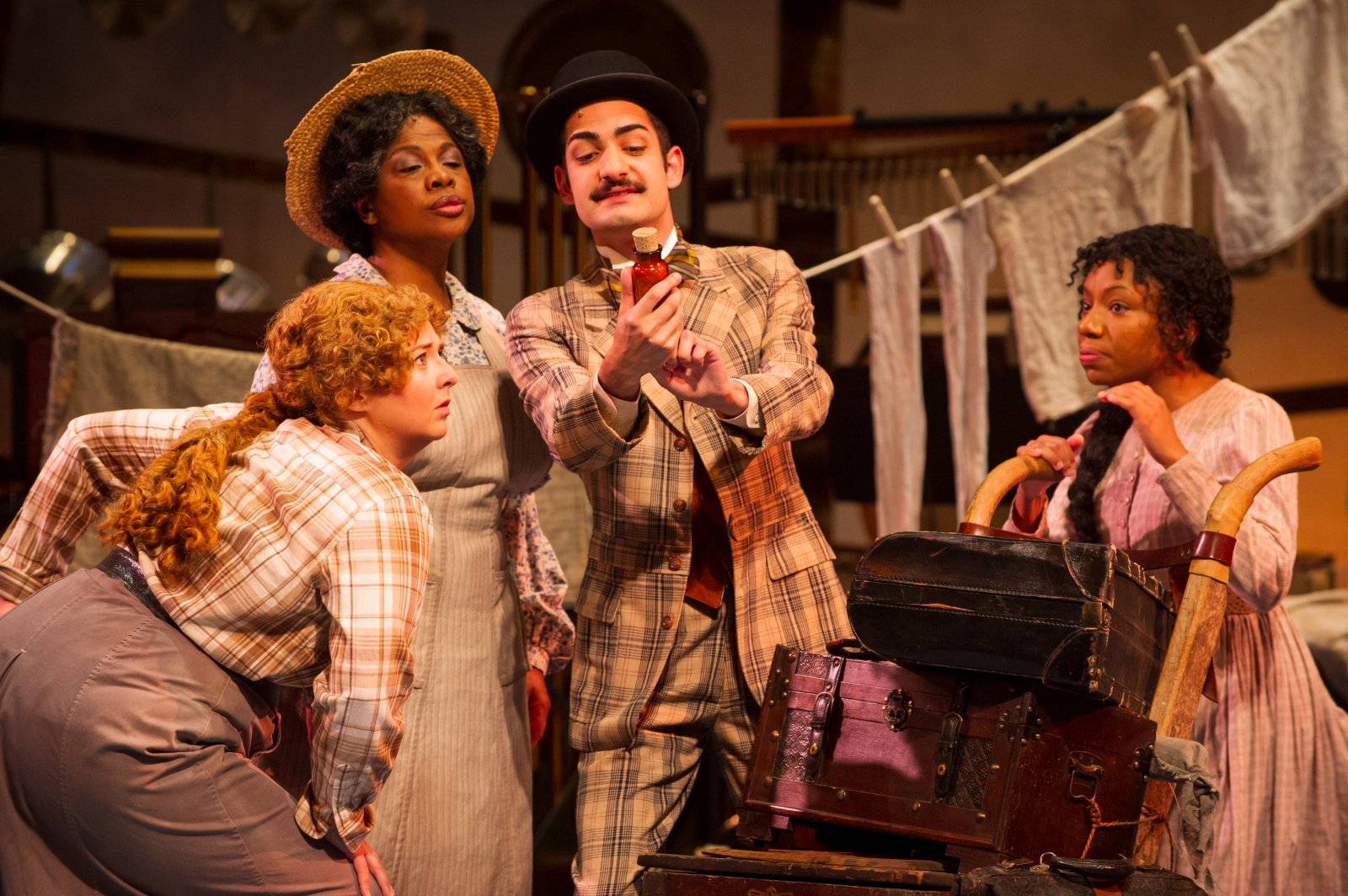 (l. to r.) Hannah Esch (Ado Annie), Cynthia Cobb (Aunt Eller), Ethan Brittingham (Ali Hakim) and Brittani Moore (Laurey Williams) in Skylight Music Theatre's production of Oklahoma! September 27 – October 13.
