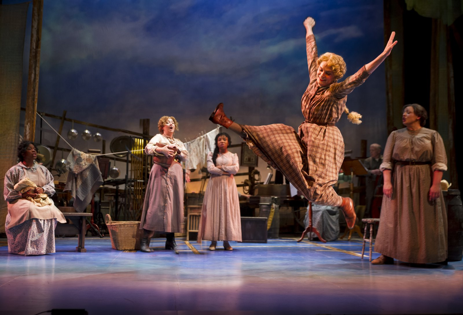 Christal Wagner (Gertie Cummings), center, dances around the cast of Skylight Music Theatre's production of Oklahoma! September 27 – October 13.