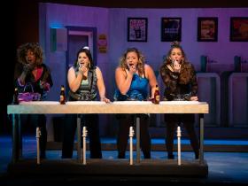 (l. to r.) Brandite Reed (Joanie Lish), Karen Estrada (Georgie Bukatinsky), SaraLynn Evenson (Estelle Genovese) and Stephanie Staszak (Susan Hershey) in Skylight Music Theatre's production of The Full Monty running September 24 – October 17, 2021.