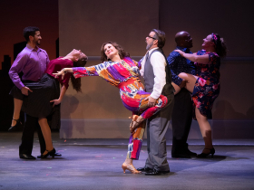 (l. to r.) Janet Metz (Vicki Nichols), Zach Thomas Woods (Harold Nichols) and the cast of Skylight Music Theatre's production of The Full Monty running September 24 – October 17, 2021.