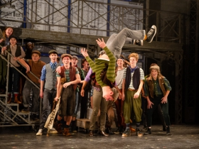 Keleous Lange (flipping, center) with the cast of Skylight Music Theatre's production of Disney's Newsies running November 15 – December 29, 2019.