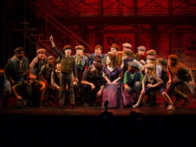 Edward Owczarski (Les, front, standing and pointing) with the cast of Skylight Music Theatre's production of Disney's Newsies running November 15 – December 29, 2019. (Note: the role of Les is double cast)