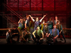 Rachael Zientek (Katherine Plumber, center) and the cast of Skylight Music Theatre's production of Disney's Newsies running November 15 – December 29, 2019.
