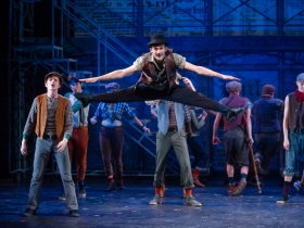 (l. to r.) Jonathan Turner (Sietz), Austin Ryan Hunt (Race), and Matthew Peterson (Henry) with the cast of Skylight Music Theatre's production of Disney's Newsies running November 15 – December 29, 2019.