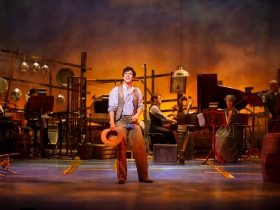 Lucas Pastrana (Curly McLain), center, in Skylight Music Theatre's production of Oklahoma! September 27 – October 13.