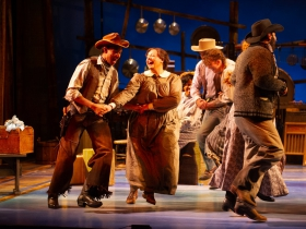 Sean Anthony Jackson (Will Parker) and SaraLynn Evenson (Kate), center, in Skylight Music Theatre's production of Oklahoma! September 27 – October 13.