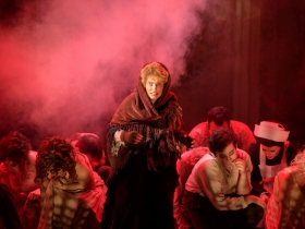 Susan Spencer (Center, Beggar Woman) surrounded by cast of Skylight Music Theatre's Sweeney Todd running May 19 – June 11.