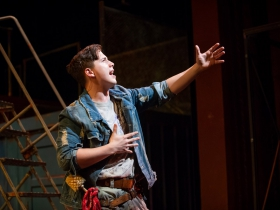 Lucas Pastrana (Bobby Strong) in rehearsal for Skylight Music Theatre's production of Urinetown, The Musical May 18 – June 10 on the Cabot Theatre stage.