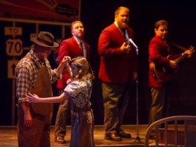 Foreground: Jeff Schaetzke (Father) and Ella Rose Kleefisch (young Violet). Background: Rick Pendzich (Radio Singer), Robby McGhee (Radio Soloist) and Ryan Stajmiger (Radio Singer) in Skylight Music Theatre's Violet