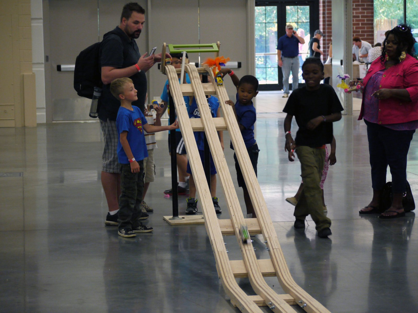 Young makers trying their new creations on the race track