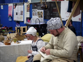 Foreground: Tailors with Old England Grown New. Background: 3D Printer from UW-Milwaukee's Digital Craft Research Lab