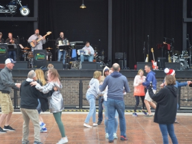 People dance at the non-stop Polka stage