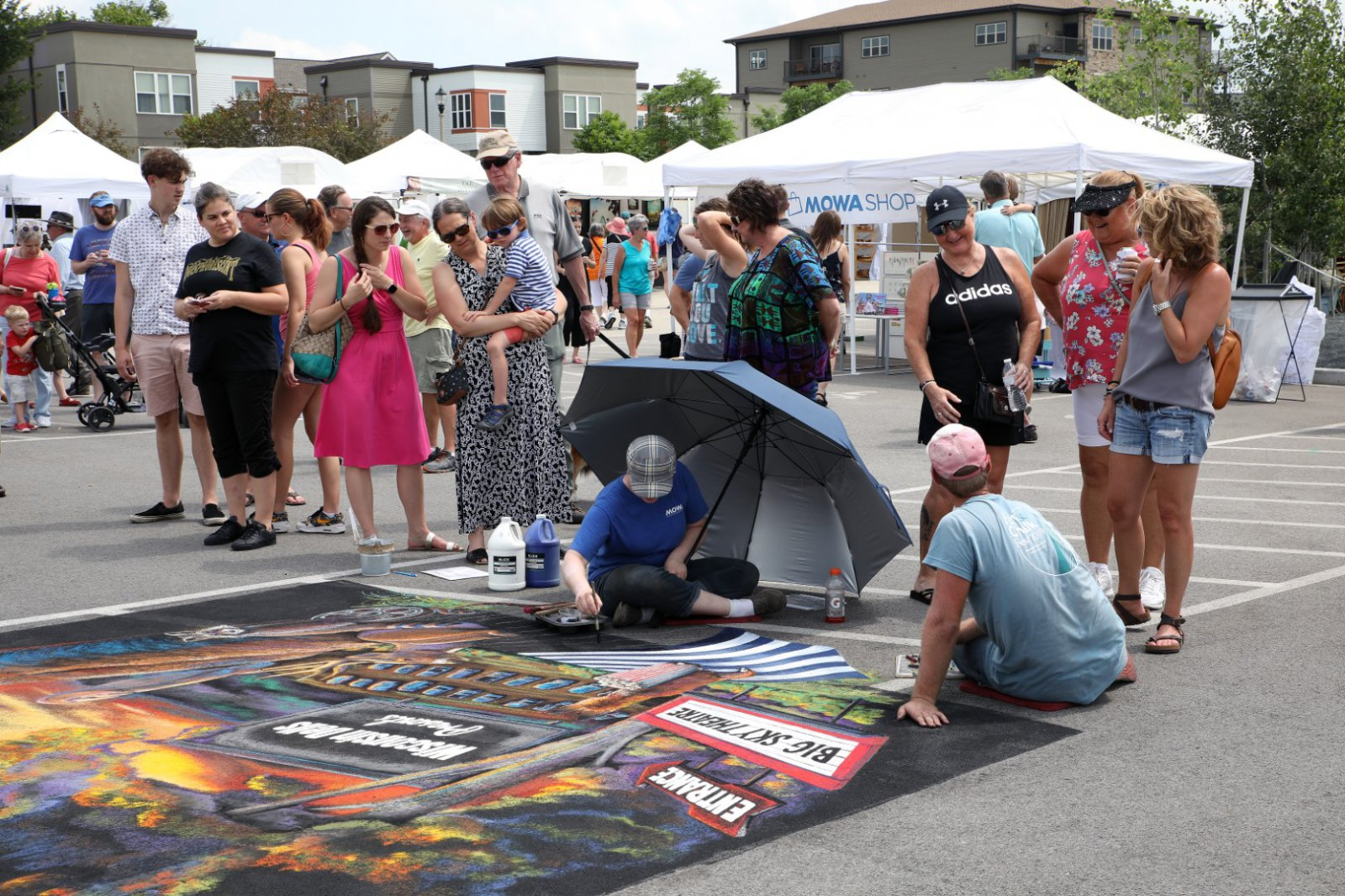 Artists, Jamie and Craig Rodgers, from Richmond Center, WI. at the 2019 MOWA, Art & Chalk Fest