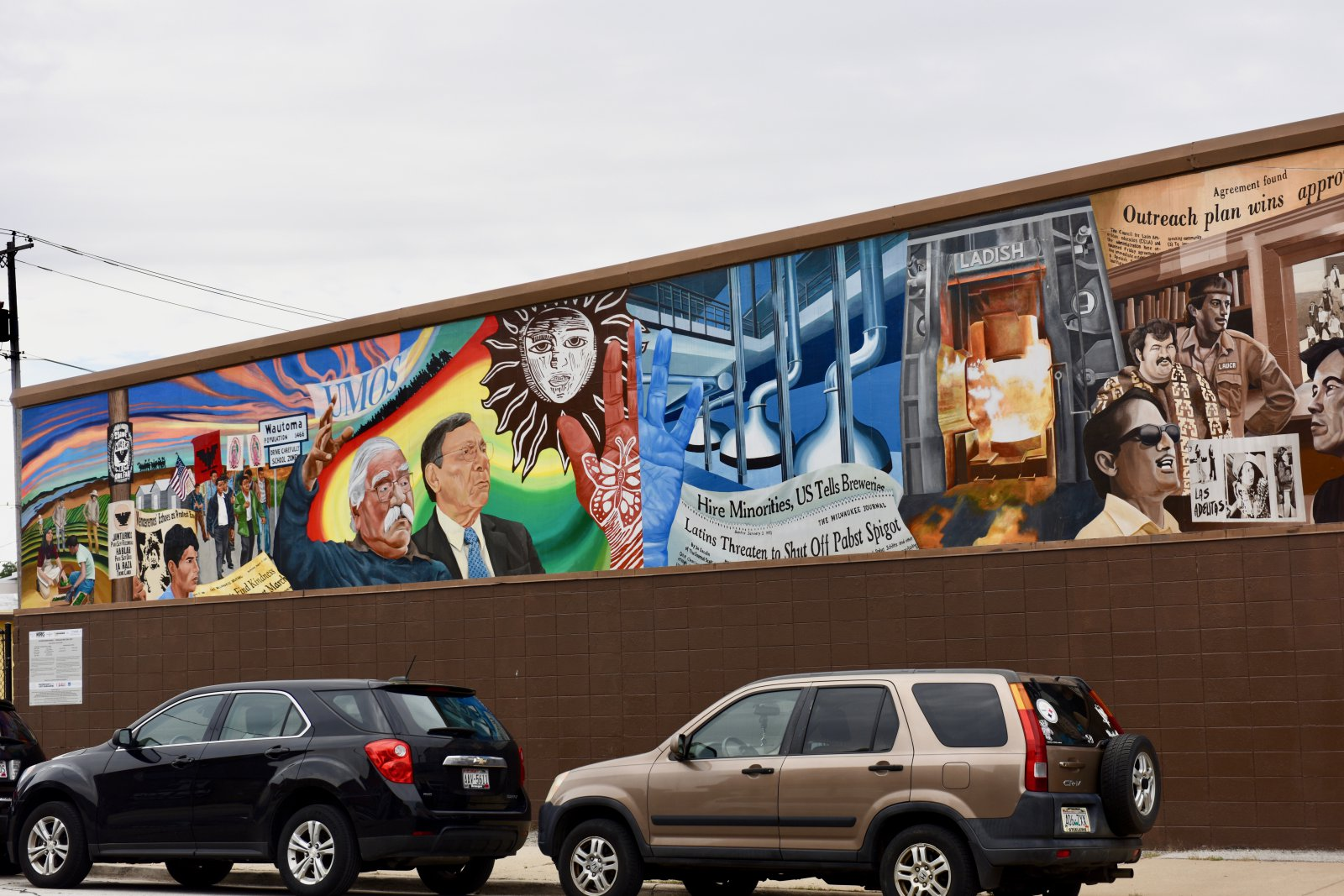 The \'Culture Work\' mural is on East Mitchel Street, on the Butters-Fetting building, and was painted by lead artists Raoul Deal as well as UWM art students and Artworks for Milwaukee interns