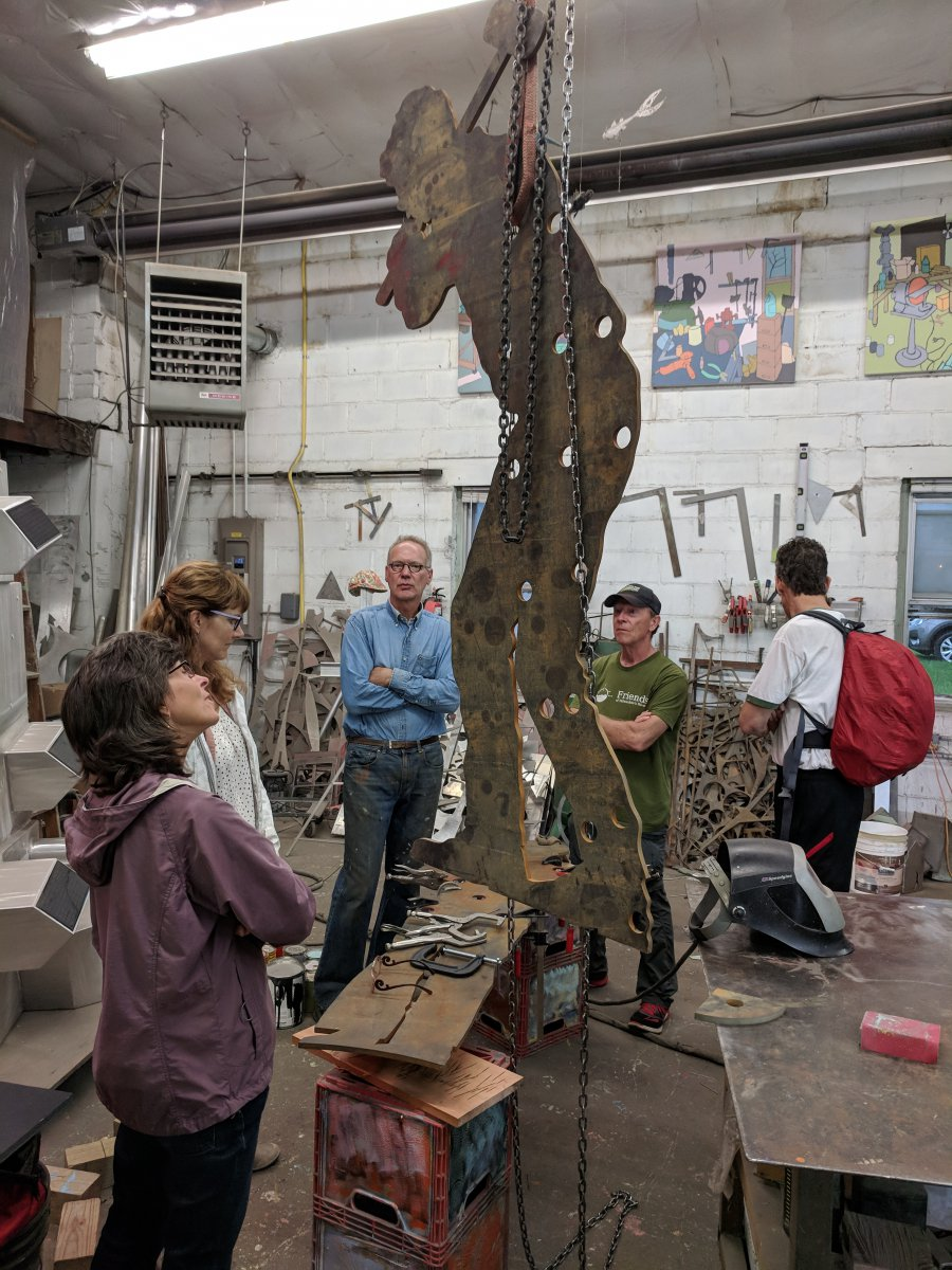 Artist Richard Taylor shows FOHAST and HAST trail manager progress on the first to sculptures out of five