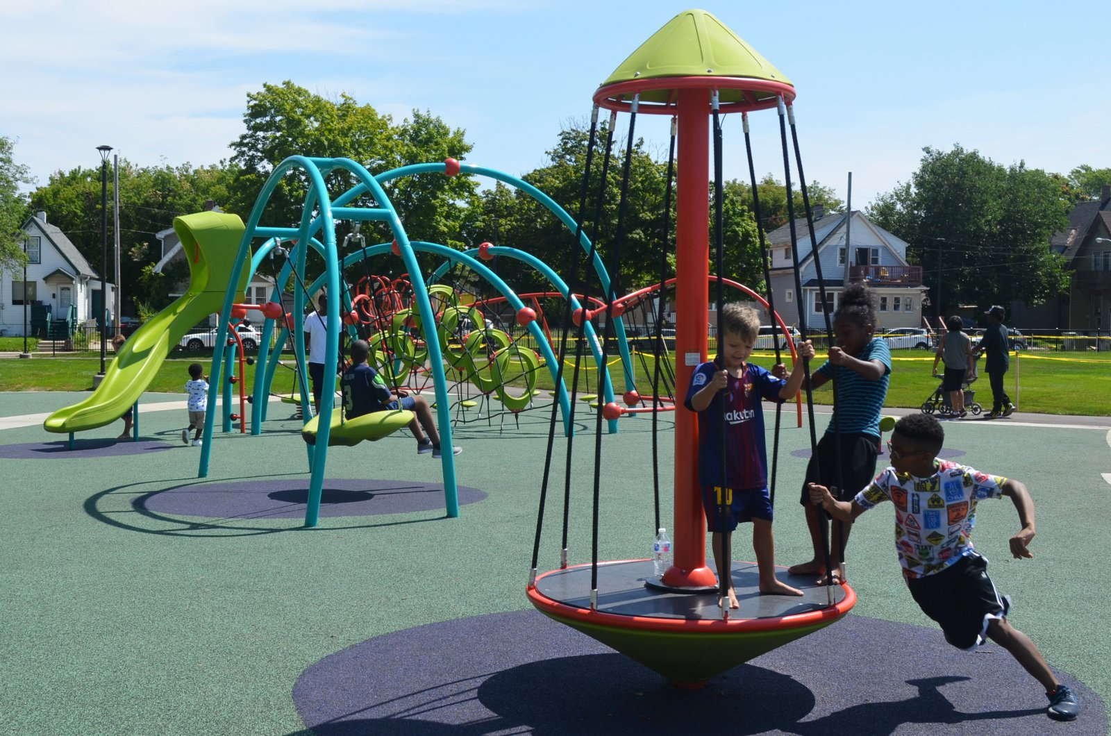 Children play at Columbia Playfield on the day of its reopening