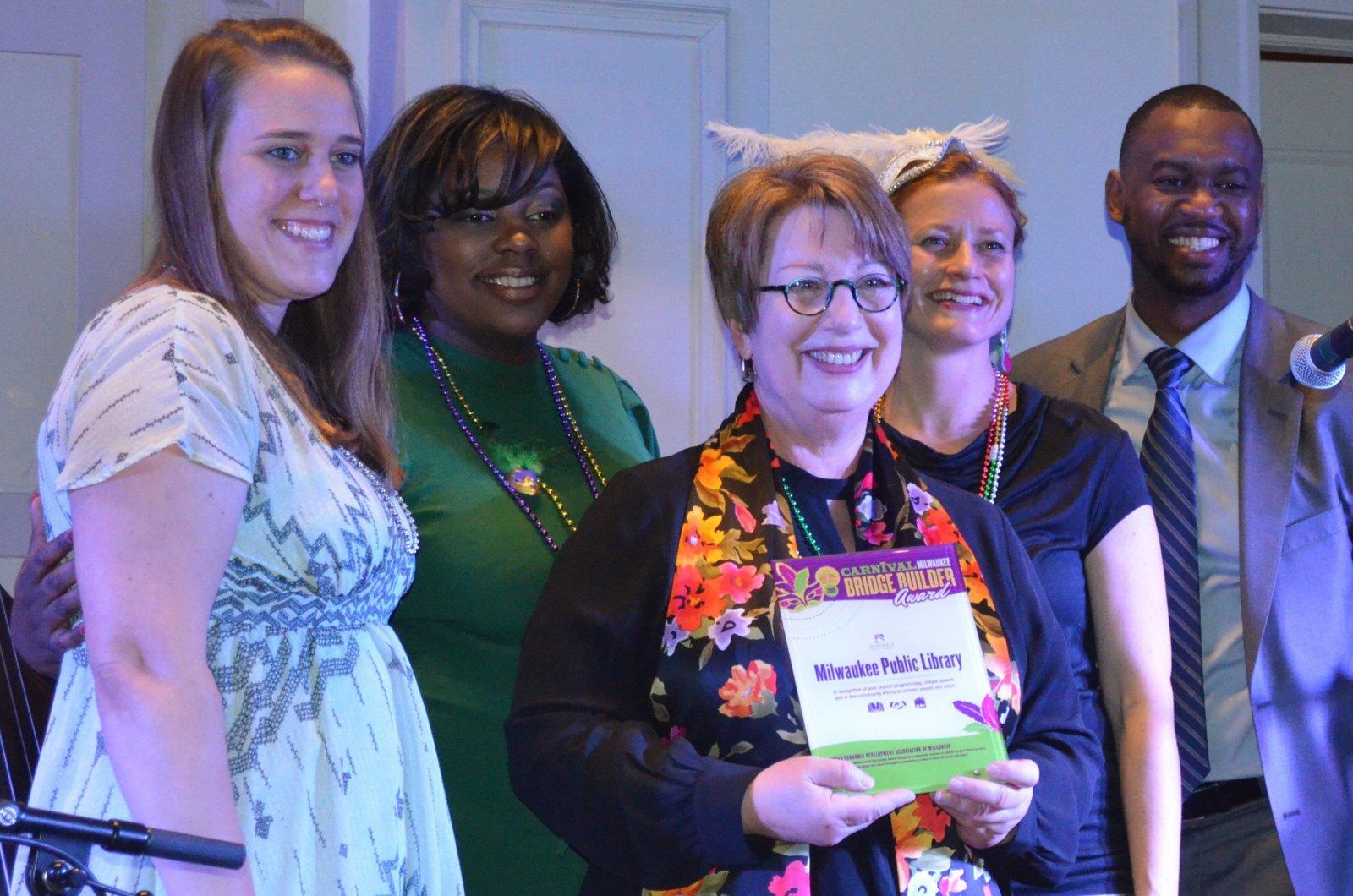 City Librarian Paula Kiely accepts UEDA\'s Bridge Builder Award at Carnival Milwaukee