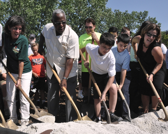 2012 - Melissa Cook (retired Hank Aaron State Trail Manager), Hank Aaron, Laura Bray (former executive director of Menomonee Valley Partners), and kids at the groundbreaking for Three Bridges Park and the Hank Aaron State Trail connecting the Valley Passage to the Mitchell Park Domes