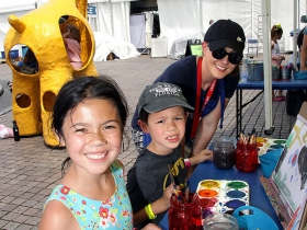 Mackenzie and Jayson from Whitefish Bay with Janelle at the Kohl's Color Wheels tent