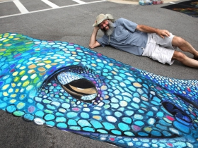 Stephen Balistreri from Barton, WI. hanging out by the chalk art of artist Shawn McCann