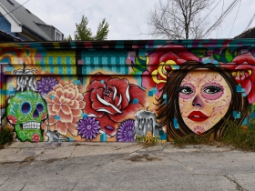 Ramiro Sandoval Argueta painted this Day of the Dead themed mural in the alley behind his tattoo shop, off West National Avenue and South 33rd Street
