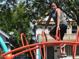 A child climbs the new play structure at Columbia Playfield