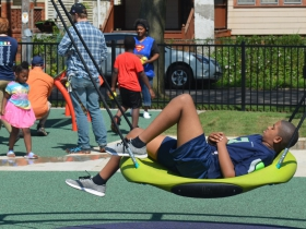 A child relaxes at Columbia Playfield on the day of its reopening