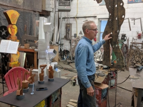 Artist Richard Taylor in his studio while sculptures in production