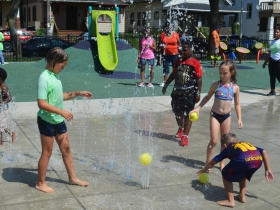 Children play at Columbia Playfield's splash pad on the day of its reopening