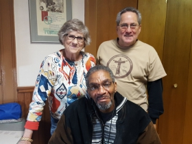 Cary (L) and Chuck (R) with Capuchin Community Services' guest, Craig, who was just fitted with new eyeglasses.