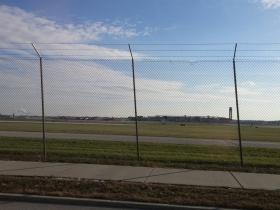E. Layton Avenue passes the airport