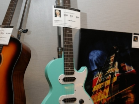 Turquoise electric guitar signed by, Michael McDonald.