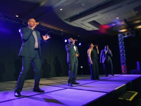 The military quartet,Voices of Service, performed at the Grand Slam Charity Jam.