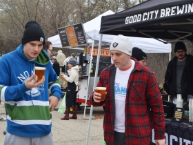 Guests drink beer from Good City Brewing at Rock the Green