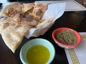Taboun bread with olive oil and spices for dipping