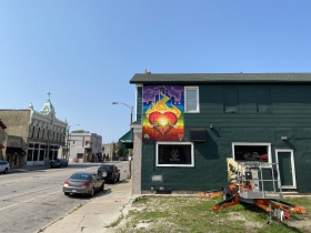 A mural by Aisha Valentin at 818 S. 2nd St.