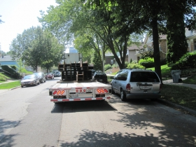 Truck delivering I-beams of United States-manufactured steel to 1641 N. Astor St.