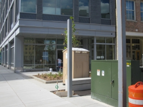 A perforated screen with the message 'Think a Positive Thought' will be installed on this utility box