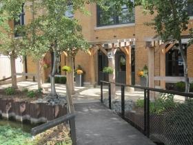 Riverwalk next to the Renaissance Building, 309 N. Water St