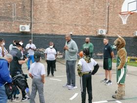 Marques Johnson talking to kids at Running Rebels