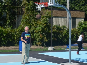Mayor Tom Barrett tries out the new basketball courts at Custer Playfield