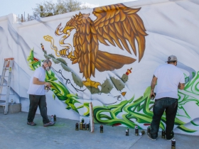 (From left) Ben Stark and Chacho Lopez work their finishing touches of the Mexico flag.