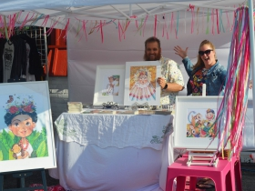 Summer Morrison [R] at her booth with her husband at Frida Fest