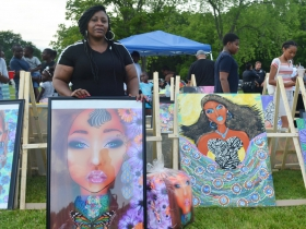 Viola Johnson Riley is pictured with art at the African Cultural Festival